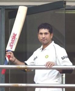 Tendulkar of India raises his bat in New Delhi
